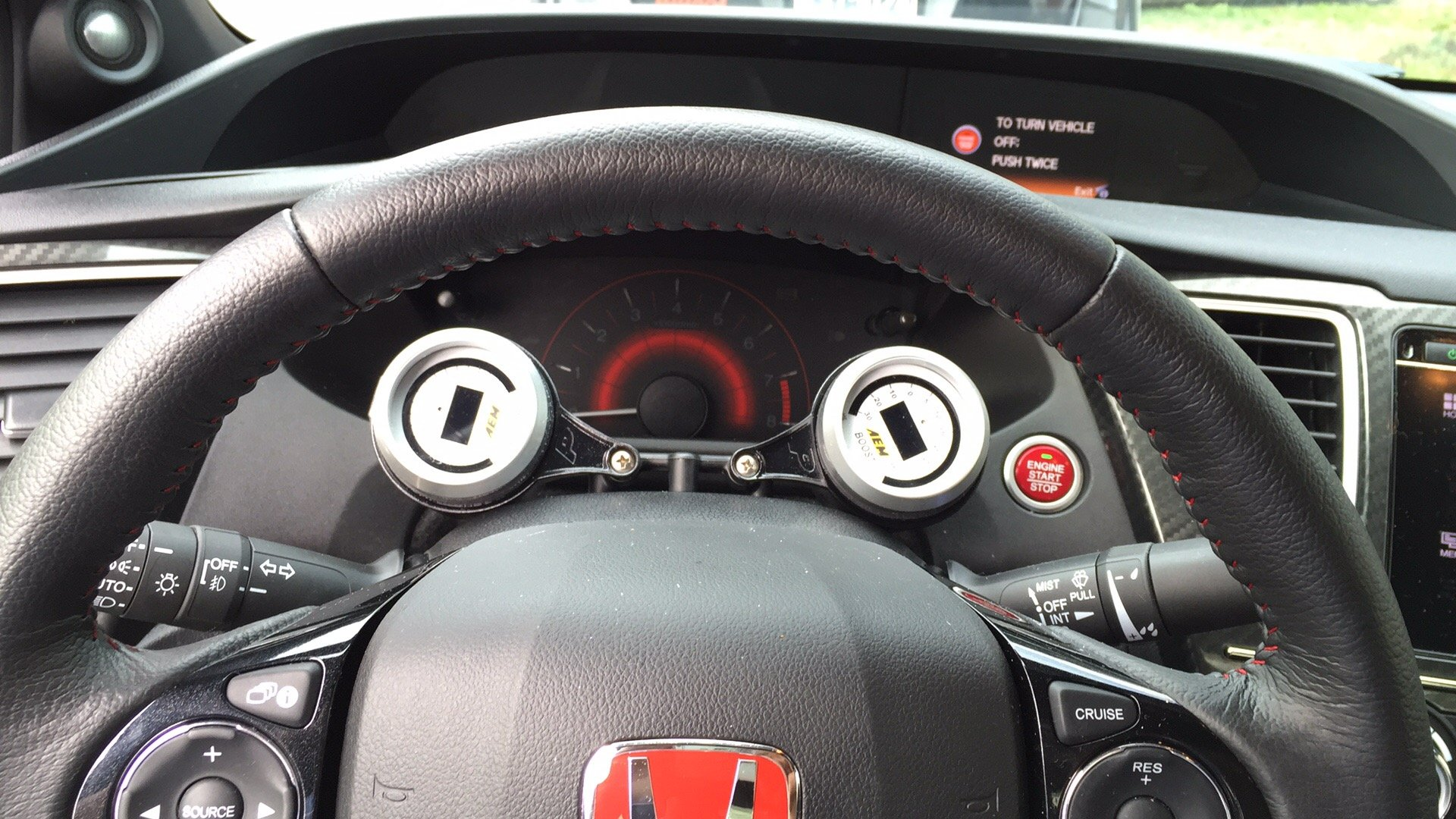 Is anyone running a boost gauge? Where did you mount?
