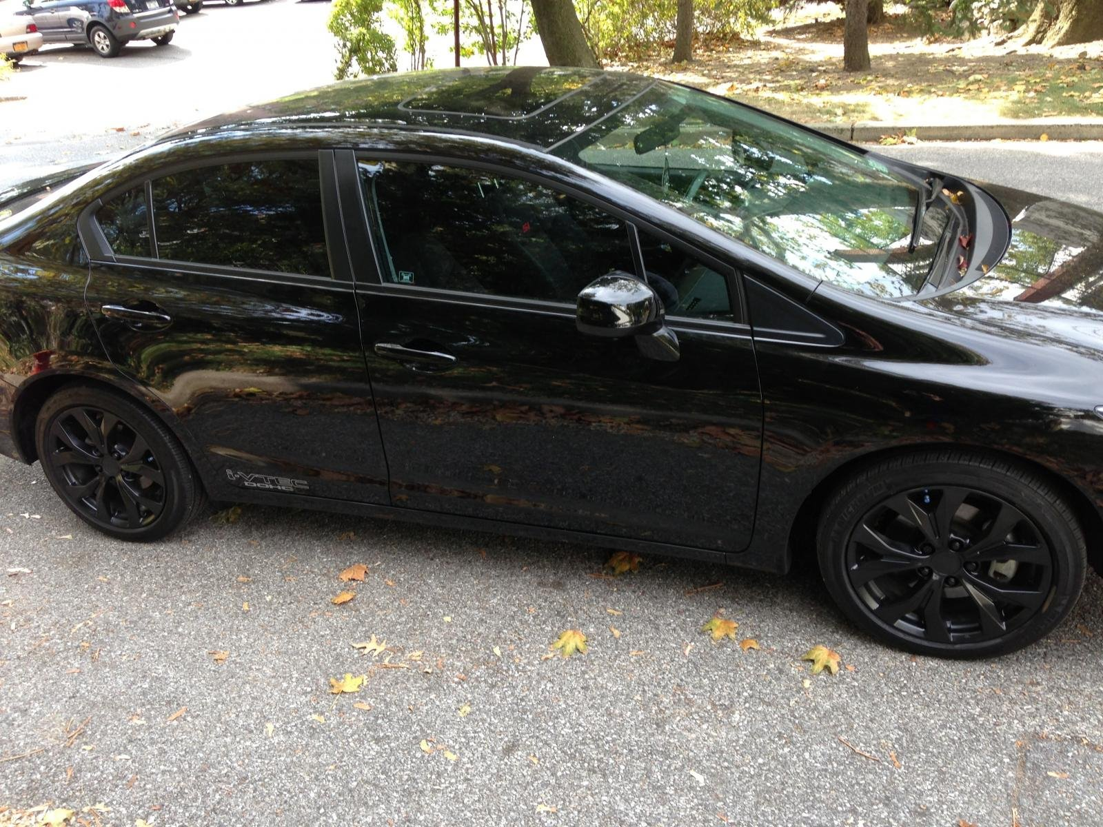 2012 Chevy Cruze Black Rims Not a great pic but to the guy